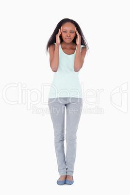 Woman having headache on a white background