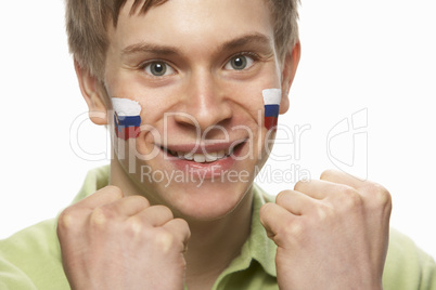 Young Male Sports Fan With Slovakian Flag Painted On Face