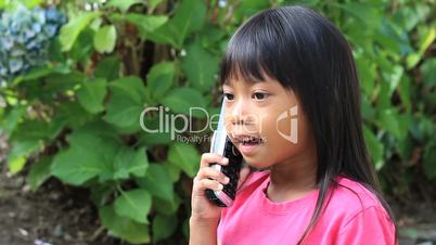 Little Asian Girl Talking On Phone
