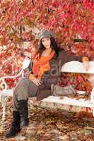 Autumn fashion portrait young woman relax bench