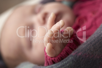 Close Up Of Hand Of Sleeping Newborn Baby Girl