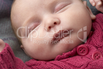 b739b43adab Portrait Of Sleeping Newborn Baby Girl. A closeup of a cute frowning baby  girl wearing hat ...