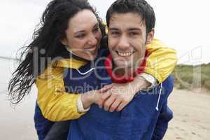 Happy couple on beach in love