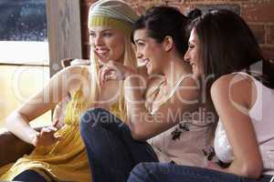 Young women sitting together and talking