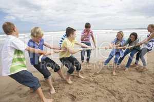 Teenagers playing tug of war