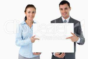 Business partners presenting sign together