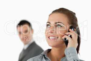 Close up of smiling businesswoman on the phone with colleague be