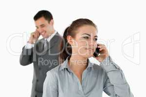 Close up of business partners talking on the phone