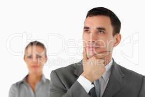 Close up of thinking businessman with colleague behind him
