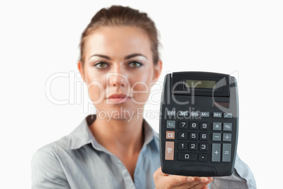 Female accountant presenting calculator
