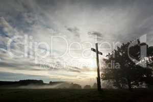 dramatic sky and a cross