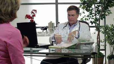 Doctor Giving a Prescription to Patient