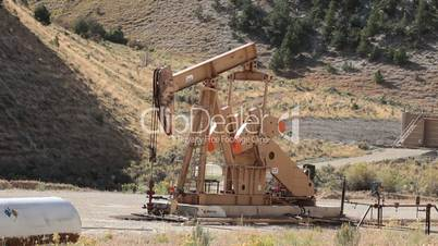 Oil well pumping crude mountain Utah fast P HD 0361