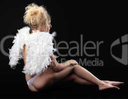 young naked girl with small angel wing