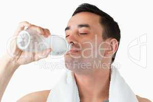 Young man enjoying a sip of water after workout