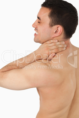 Young male suffering from neck pain