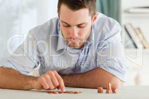 Businessman counting his small change