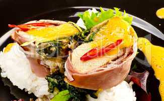 Salmon in ham covers and spinach