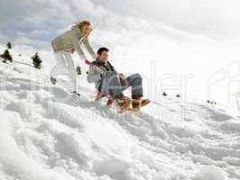 Young Couple Sledding