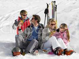 Young Family Sharing A Picnic On Ski Vacation