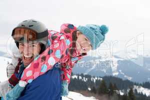 Young Father And Daughter On Winter Vacation
