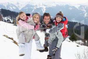 Young Family On Winter Vacation