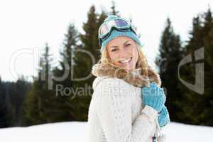 Young Woman  In Alpine Snow Scene