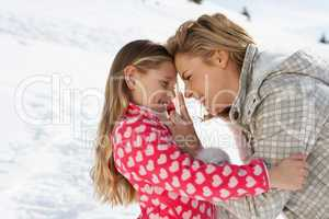Young Mother And Daughter On Winter Vacation