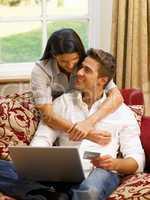 Young Hispanic couple shopping online