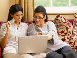 Hispanic mother and daughter shopping online