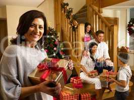 Hispanic family exchanging gifts at Christmas