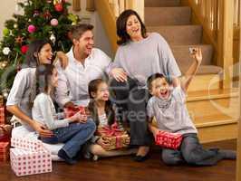 Hispanic family taking photos at Christmas