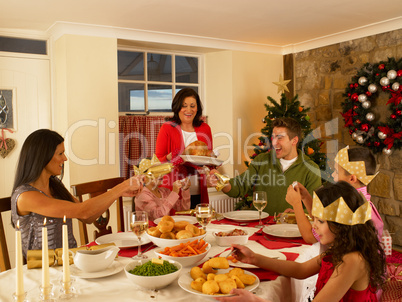 Hispanic family having Christmas dinner