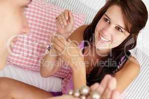 Teenage girls trying on jewellery