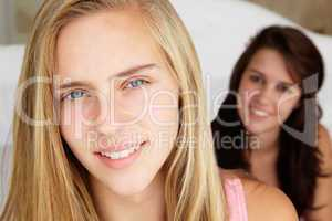 Head and shoulders portrait of teenage girls