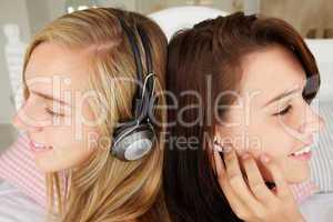 Teenage girls listening to music