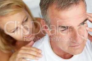 Woman comforting anxious husband