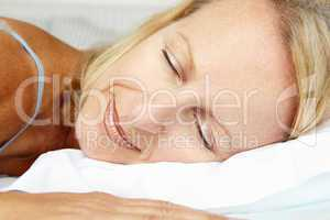 Head and shoulders mid age woman sleeping