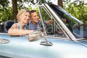 Couple in sports car