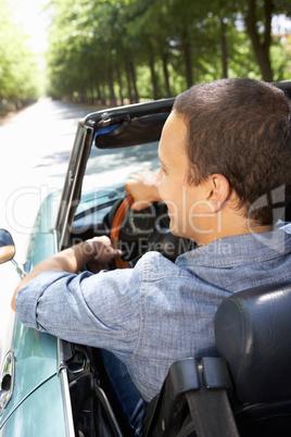 Man in sports car
