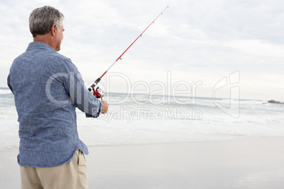 Senior man fishing in sea