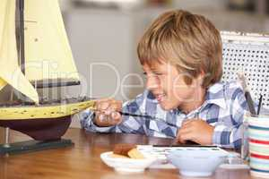 Young boy making model ship
