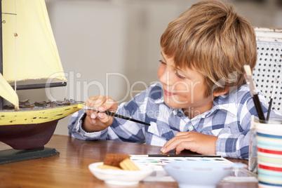 Young boy making model ship