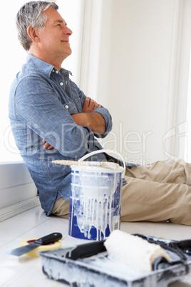 Senior man decorating house