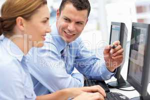 Business man and woman working on computers