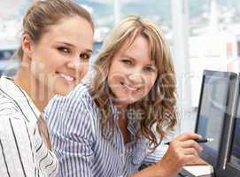 Businesswomen working on computers