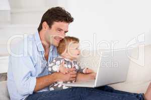 Busy father working on laptop