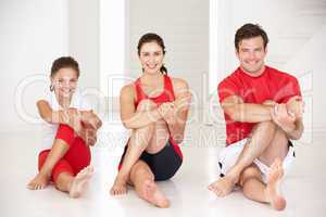 Mother,father and daughter doing yoga
