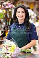 Hispanic woman working in florist