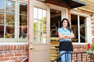 Woman standing outside bakery/café